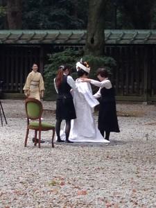 Japanese bride being prepared in Meiji Shrine for her wedding